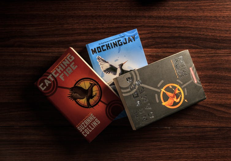 Cover of three books from the Hunger Games series