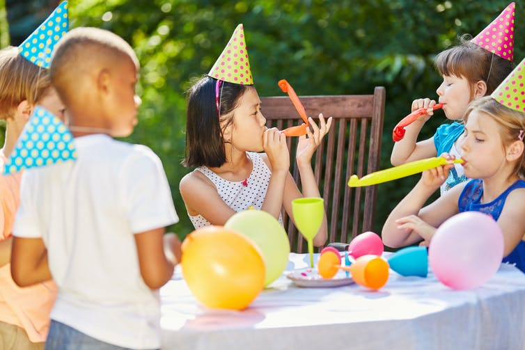 Children celebrate at a birthday party.