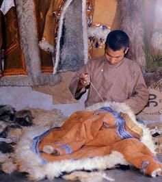 boy makes afghan coat