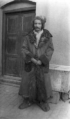 man in long coat