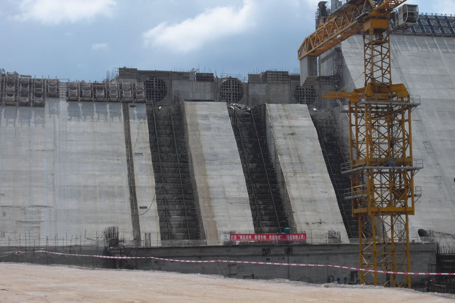 Crane and dam wall under construction