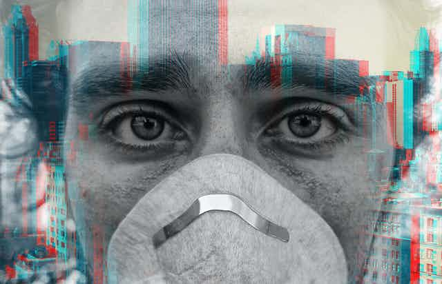 Double exposure of person wearing face mask and city buildings
