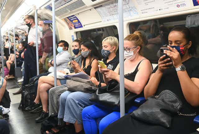 Commuters wearing masks on the London Underground