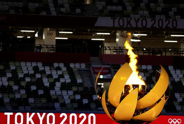 A picture shows the Olympic Flame and Cauldron during the opening ceremony of the Tokyo 2020 Olympic Games, at the Olympic Stadium, in Tokyo
