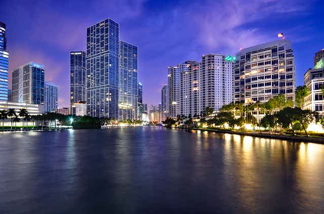 Dusk view of Miami towers along a bay and river