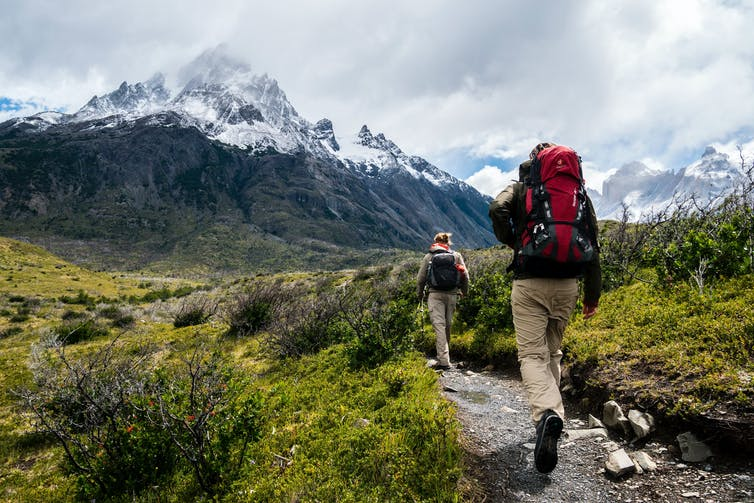 Two hikers on mountain trail