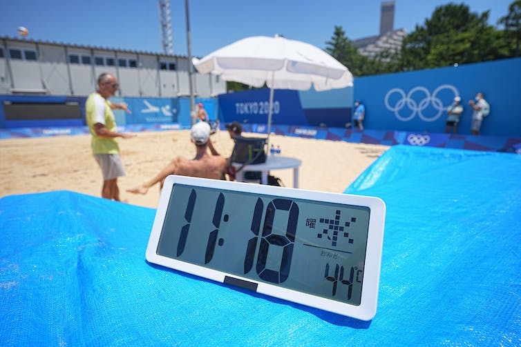 A thermometre shows 44C at 11am on a beach volleyball practice court in Tokyo