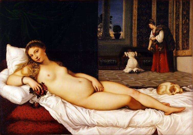 Woman reclines on chaise lounge naked.