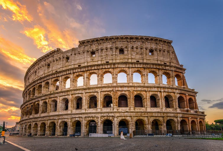 The Colosseum in Rome at sunset.