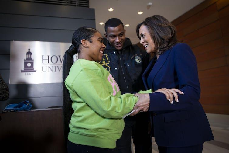Kamala Harris greets a college student at Howard University