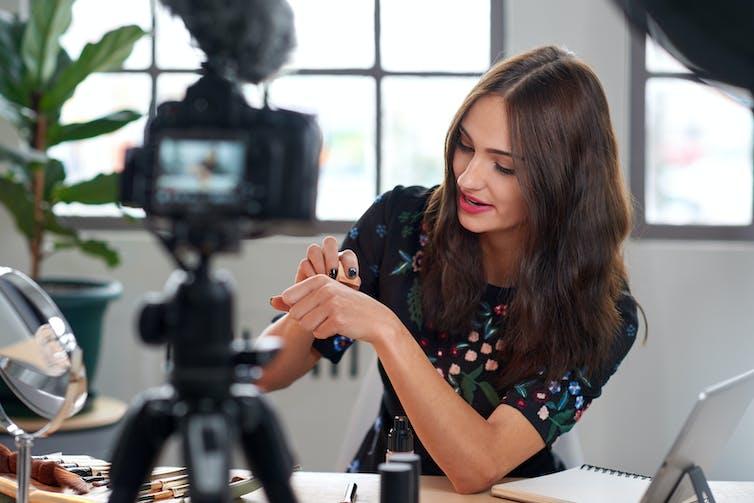 Beauty vlogger being filmed.
