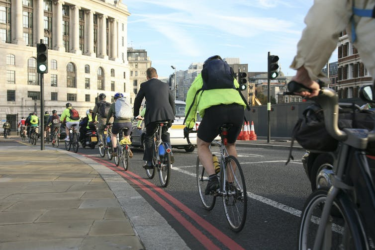 Commuters cycling to work in London