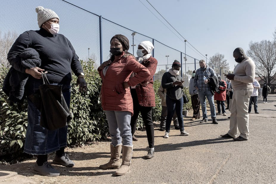 People wearing masks standing in a line