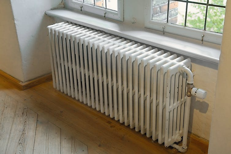 Old radiator against a wall