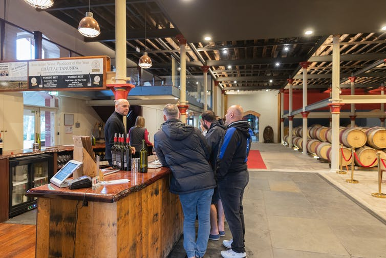 tourists at wine tasting