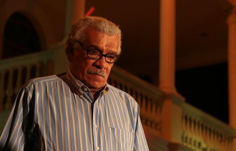 An older man wearing glasses