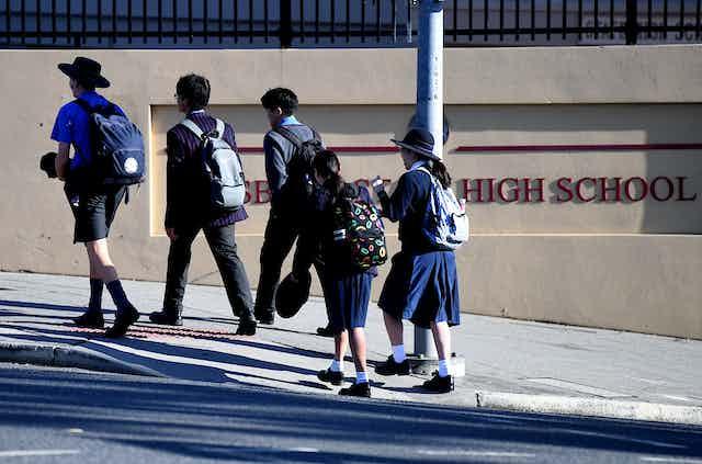 Children arrive at a high school in Brisbane