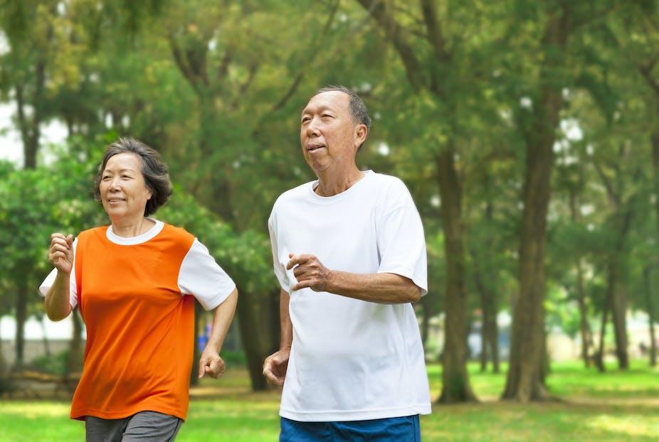 Older couple on a jog together.