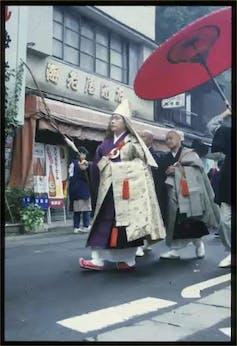 Shinto priests in purification ceremony/festival in Yokohama.