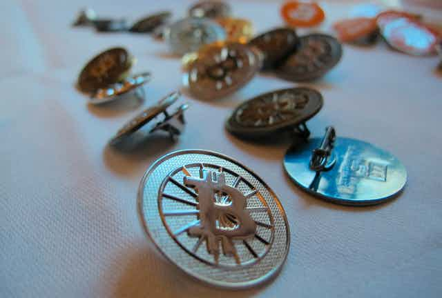 A bunch of bitcoin buttons are sitting on a table