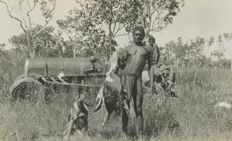 black and white photo of figures in outback
