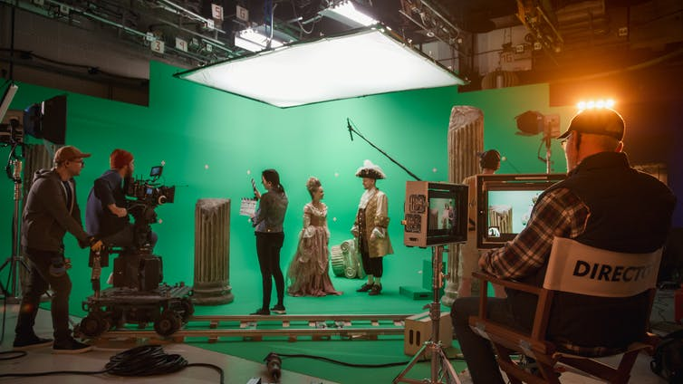 Director and camera crew on film set