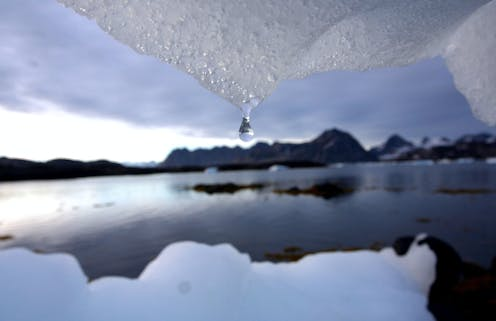 water drips from ice into a bay in Greenland.