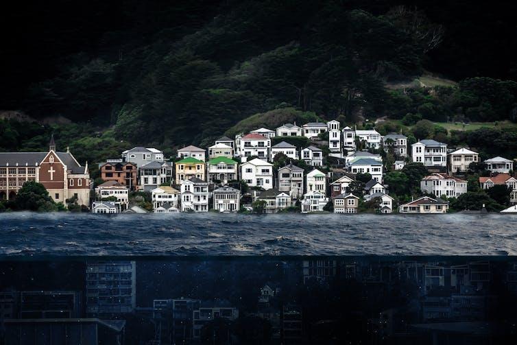 Ocean ways against a coastal city.