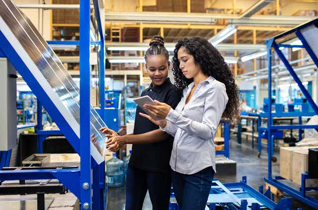 two women working together in a warehouse