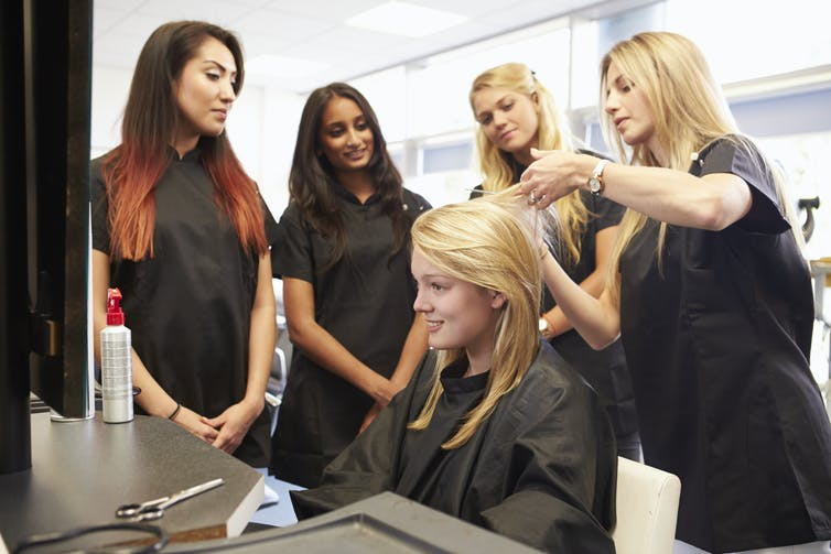 Hairdressing students learning.