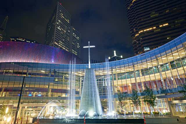 The facade of the 'First Baptist Church' Southern Baptist megachurch in central Dallas at night.