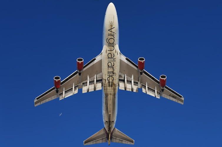 A Virgin Atlantic plane viewed from below