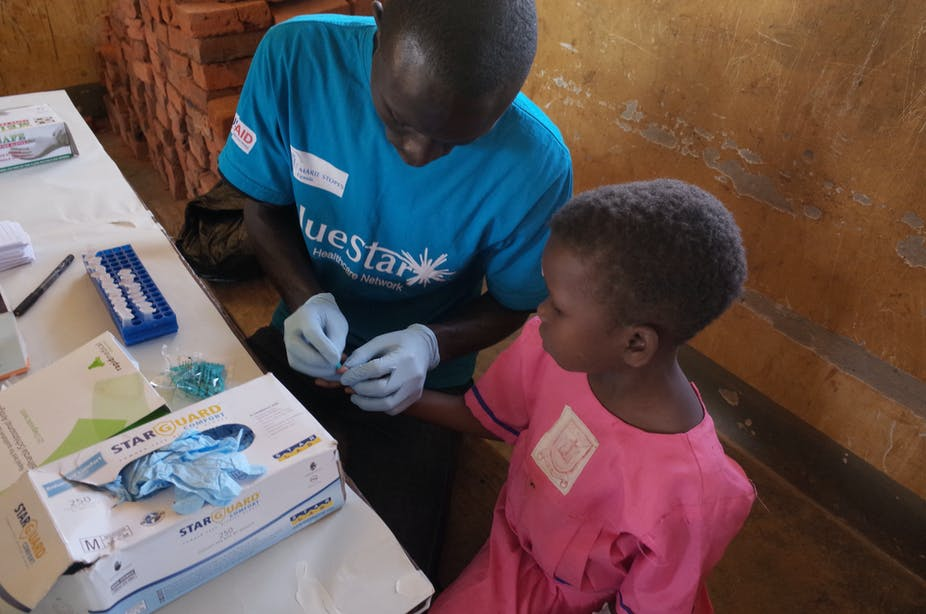 A child getting tested for malaria