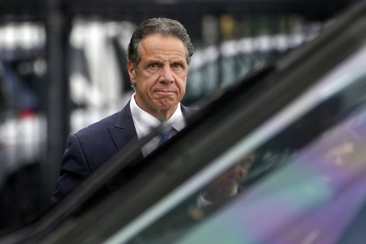 New York Gov. Andrew Cuomo grimaces as he prepares to board a helicopter
