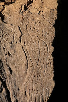 etched outline of a figure instone