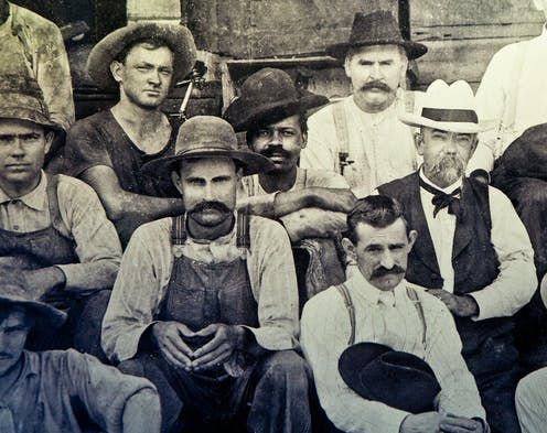 A group of men pose in an 1870 photograph.