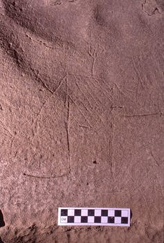 Outline of a human etched into stone