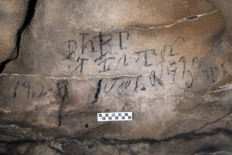 Inscription on cave wall written in Cherokee syllabary