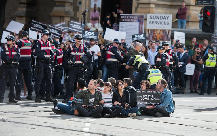 Animal rights activists block a Melbourne CBD intersection in 2019.
