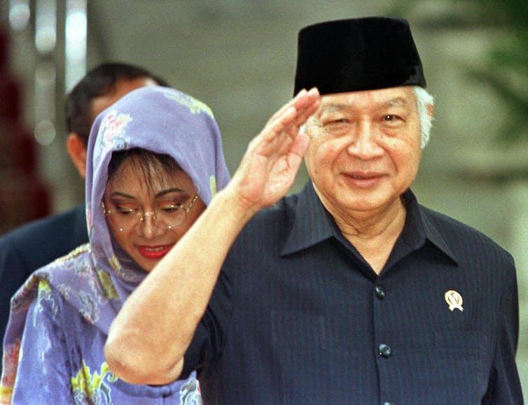 Soeharto salutes after his 1998 resignation.