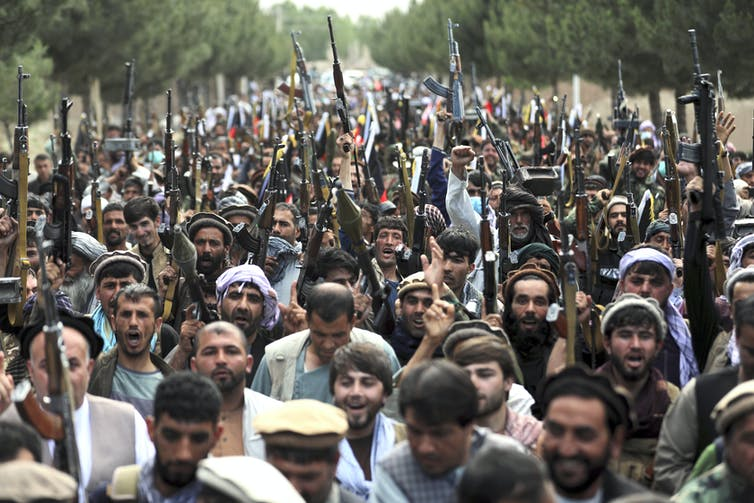 A crowd of Taliban fighters and supporters.