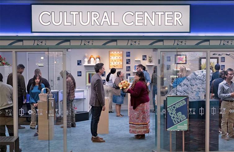 Characters stand in a 'cultural centre'