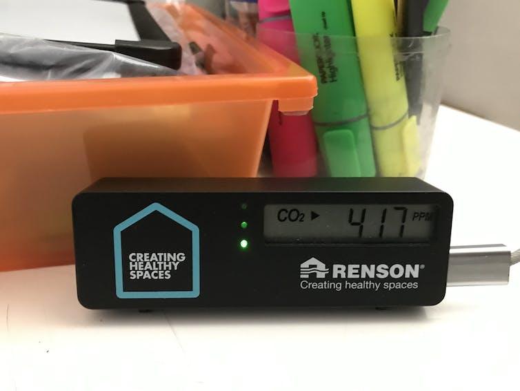CO₂ monitor in school showing 417ppm