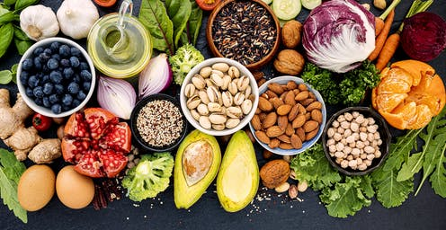 Variety of healthy foods, including nuts, berries and vegetables