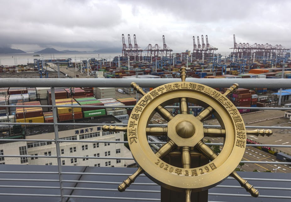 A commemorative ship's wheel overlooking the port of Ningbo-Zhousan