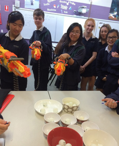 Students use nerf guns to model photons ejecting electrons