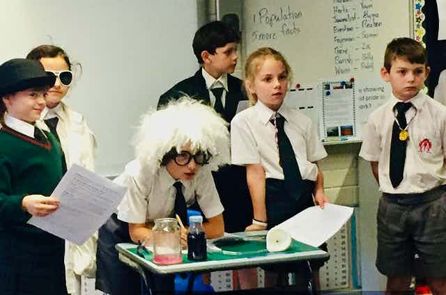 Primary school students perform in a play about Einsteinian science