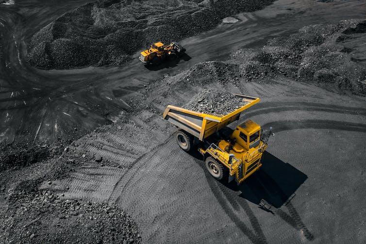 Two trucks in an open pit coal mine