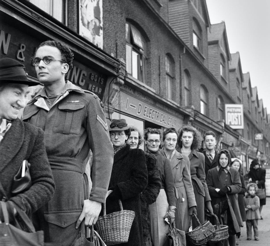 Shoppers in a queue outside in the 1940s