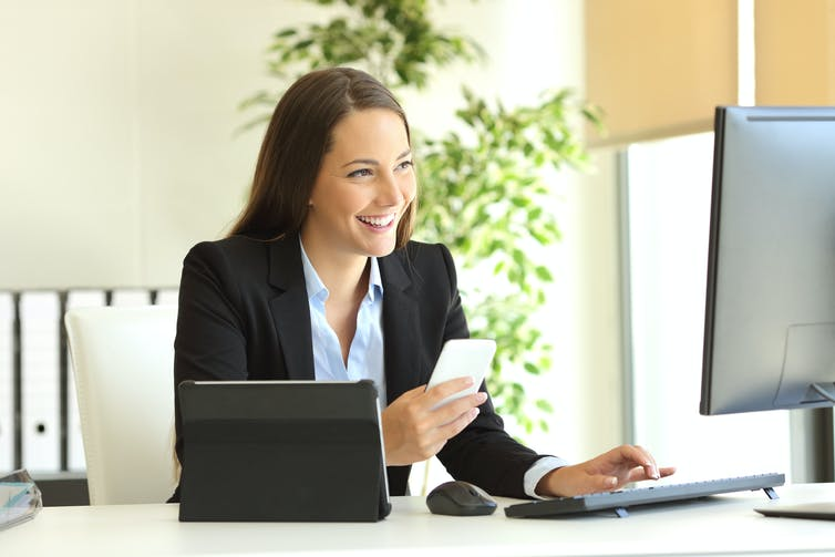 happy woman reading emails